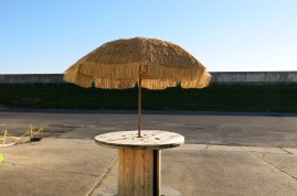 Tiki table in the parking lot / drining area